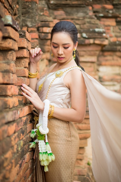 Beautiful woman in thai old traditional costume , portrait at the ancient ayutthaya temple. Free Photo