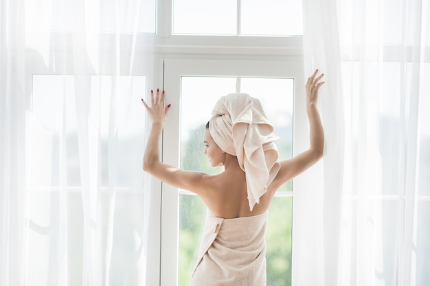 Beautiful woman in the towel after bathing Premium Photo