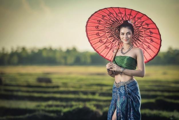 Beautiful woman in traditional dress costume, asian woman wearing typical thai dress Premium Photo