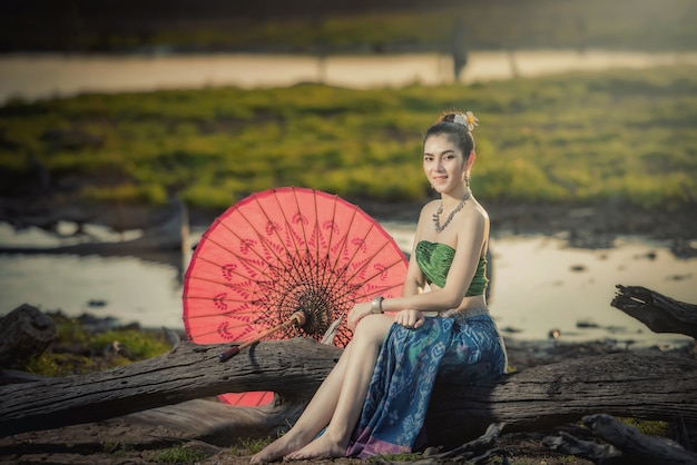 Beautiful woman in traditional dress costume, asian woman wearing typical thai dress Premium Photo