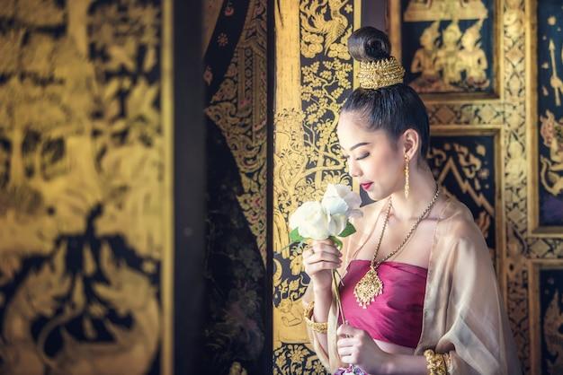 Beautiful woman in traditional dress costume Premium Photo