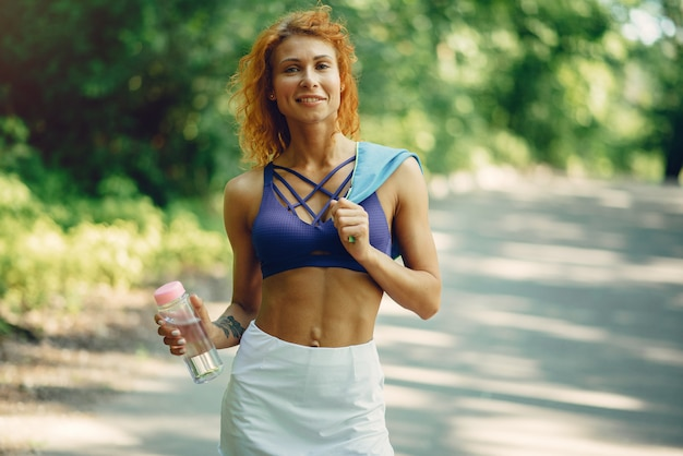Beautiful woman training in a summer park Free Photo