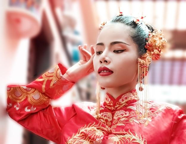 The beautiful woman wearing chinese costume<portrait of model posing,new year festival,blurry light around Premium Photo