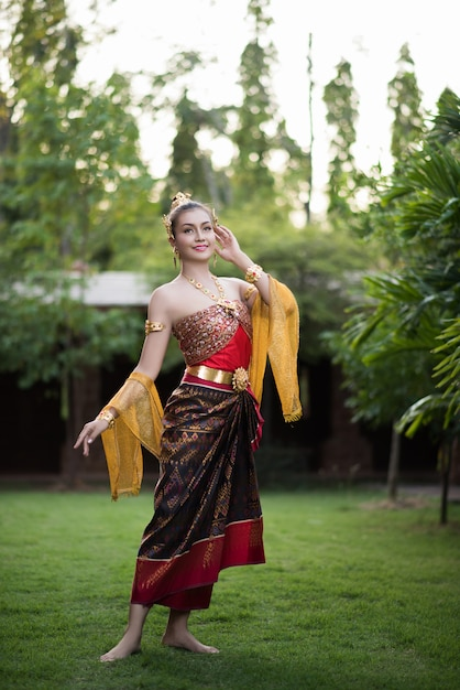 Beautiful woman wearing typical thai dress Free Photo