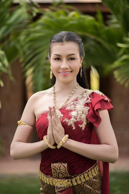 https://image.freepik.com/free-photo/beautiful-woman-wearing-typical-thai-dress_1150-5444.jpg