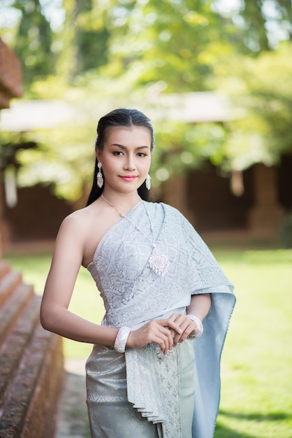 https://image.freepik.com/free-photo/beautiful-woman-wearing-typical-thai-dress_1150-5482.jpg