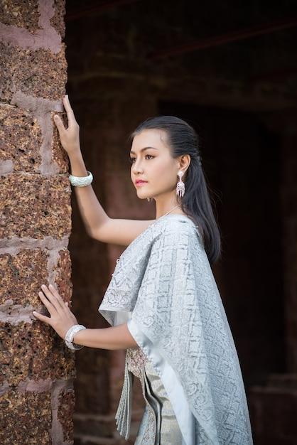 Beautiful woman wearing typical thai dress Free Photo