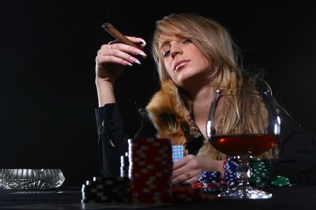 Beautiful woman which smoke cigar Free Photo