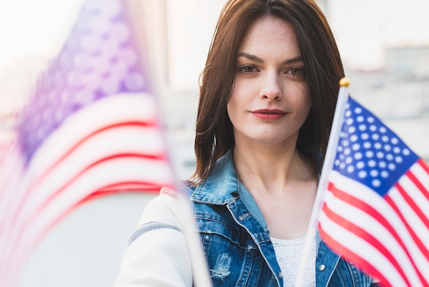 Beautiful woman with american flags Free Photo