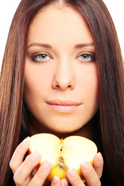 Beautiful woman with apple in hands Free Photo