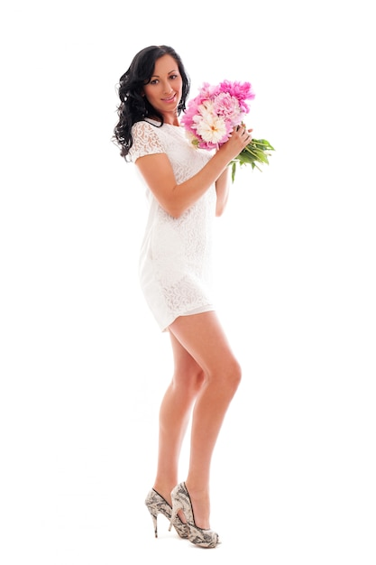 Beautiful woman with bouquet of peonies Free Photo