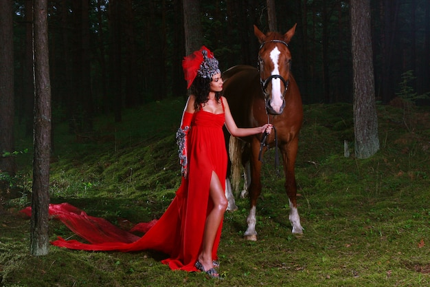 Beautiful woman with brown horse Free Photo
