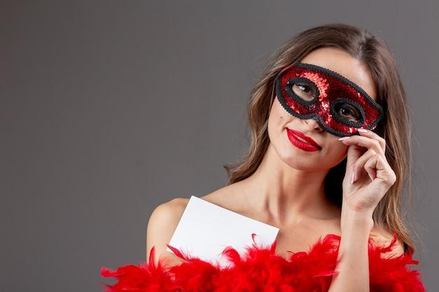 Beautiful woman with carnival mask Free Photo