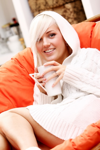 Beautiful woman with cup of hot drink Free Photo