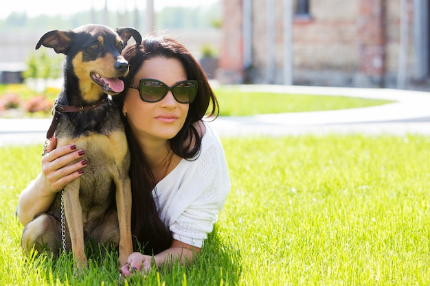Beautiful woman with dog Free Photo