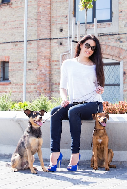 Beautiful woman with dogs Free Photo