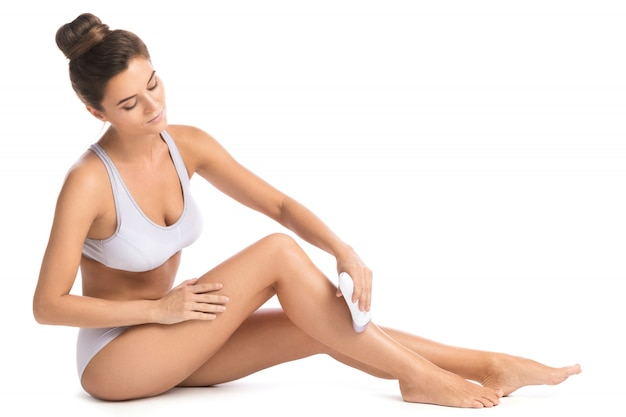 Beautiful woman with epilator Premium Photo