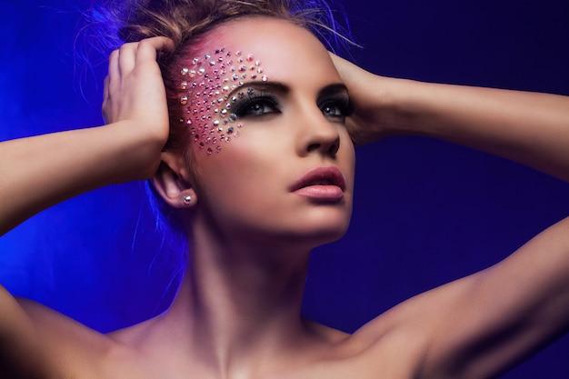 Beautiful woman with fantasy makeup Free Photo
