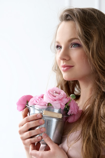 Beautiful woman with flowers Free Photo