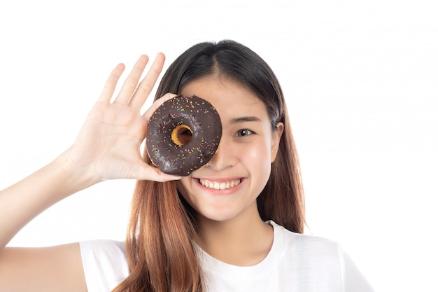 Beautiful woman with a happy smile holding a hand donut, isolated on white background. Free Photo