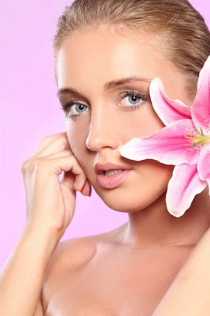 Beautiful woman with lily flower Free Photo