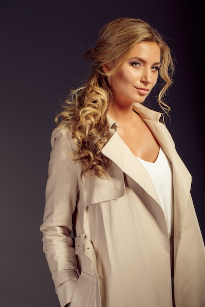 Beautiful woman with long blond hair in beige fur coat Premium Photo