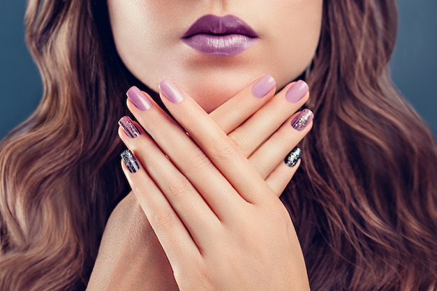 Beautiful woman with perfect make-up and manicure. Premium Photo
