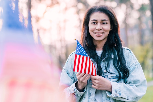 Beautiful woman with souvenir american flag outdoors Free Photo