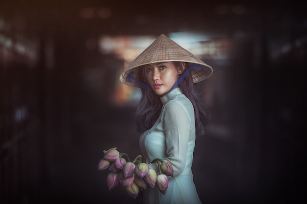 Beautiful woman with vietnam culture traditional dress, traditional costume , vintage style, vietnam Premium Photo