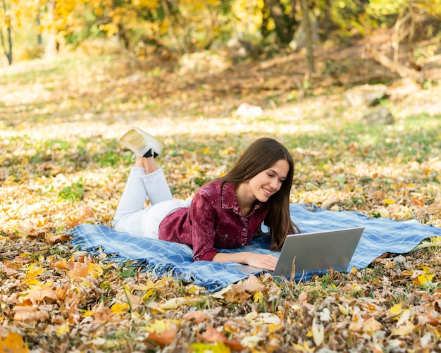 Beautiful woman working on her laptop Free Photo