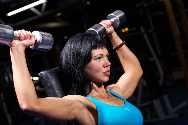 Beautiful woman working out in a gym Free Photo