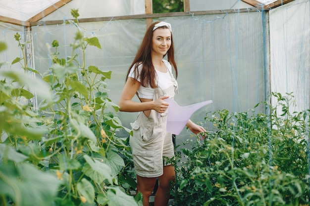Beautiful woman works in a garden Free Photo