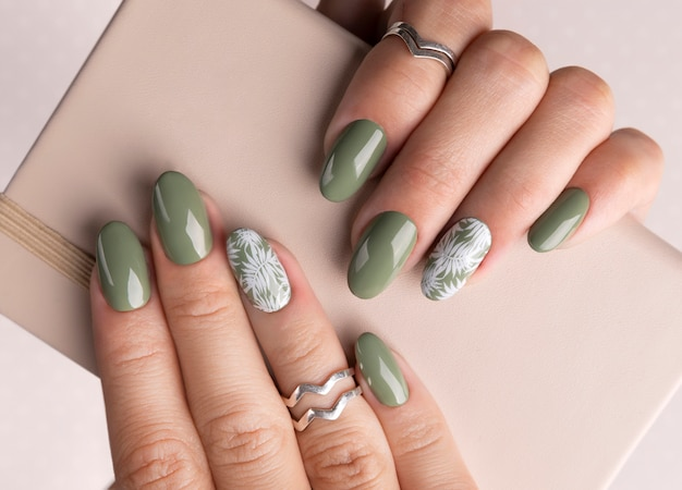 Beautiful womans hands with spring summer floral nail design Premium Photo