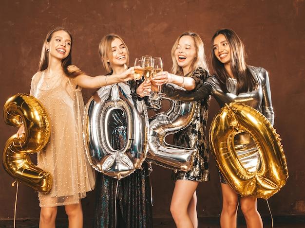 Beautiful women celebrating new year.happy gorgeous girls in stylish sexy party dresses Free Photo
