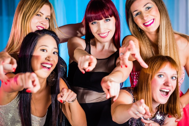 Beautiful women dancing in discotheque or club Premium Photo