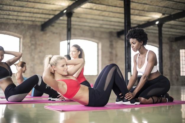 Beautiful women doing exercises in the gym Premium Photo
