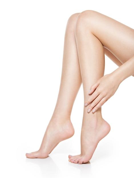 Beautiful women feet isolated on white. close-up. Free Photo