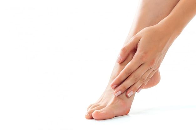 Beautiful women feet isolated on white close-up Premium Photo