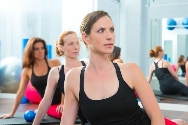 Beautiful women group in a row at aerobics class Premium Photo