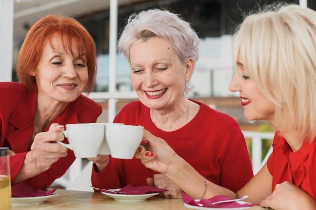 Beautiful women having a coffee Free Photo