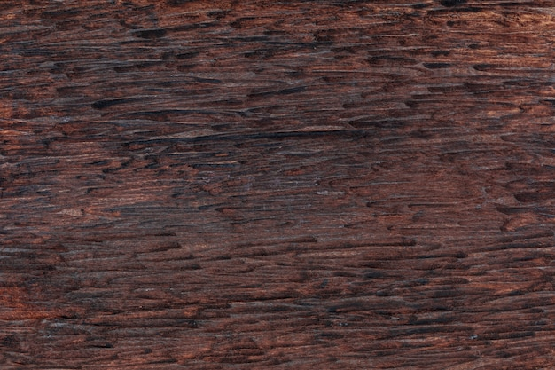 Beautiful wooden background. of rustic aspect and dark, ocher, brown, toasted, black tones. the veins and knots are appreciated. Premium Photo
