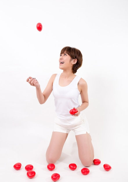 Beautiful young asia woman with red hearts. isolated on white background. Premium Photo