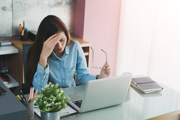 Beautiful Young Asian Girl Feeling Headache And Stress In Office Space  Background Premium Photo