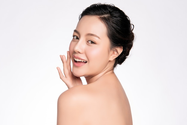 Beautiful young asian woman touching her clean face with fresh healthy skin, isolated, beauty cosmetics and facial treatment concept Premium Photo