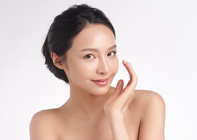 Beautiful young asian woman with clean fresh skin on white background, face care, facial treatment, cosmetology, beauty and spa, asian women portrait Premium Photo