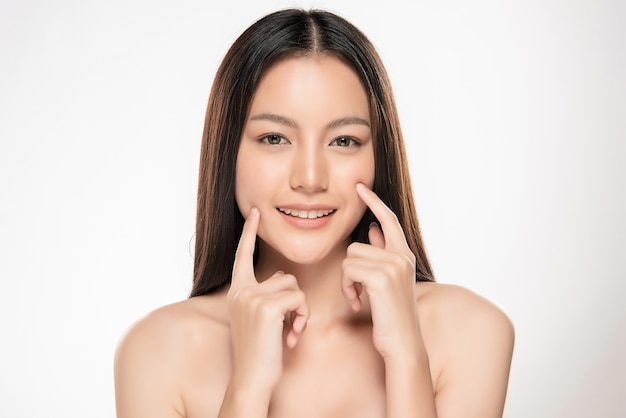 Beautiful young asian woman with clean fresh skin Premium Photo