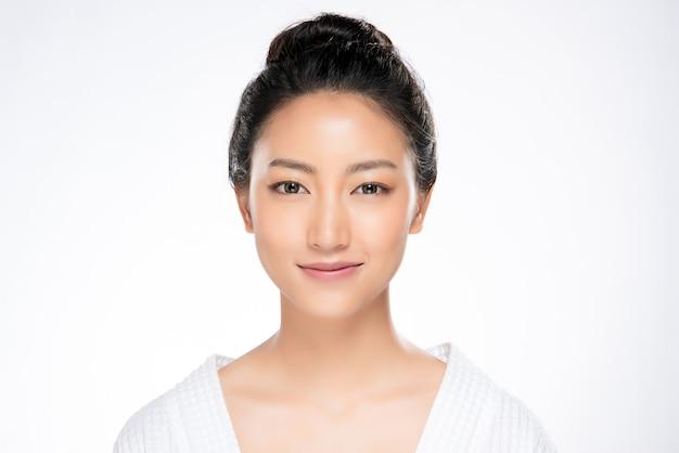 Beautiful young asian woman with clean fresh skin Premium Photo