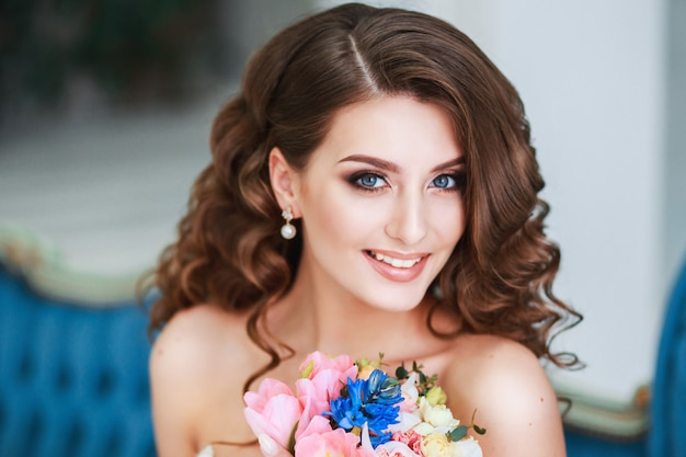 Beautiful young bride with wedding makeup and hairstyle indoor .closeup portrait of young gorgeous bride Premium Photo