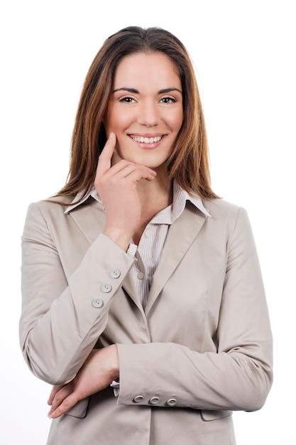 白で隔離ポーズの美しい若いビジネス女性 無料写真