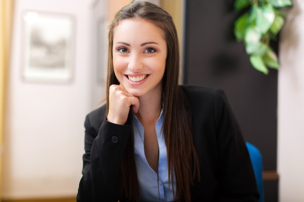 Beautiful young businesswoman sitting in her office Premium Photo